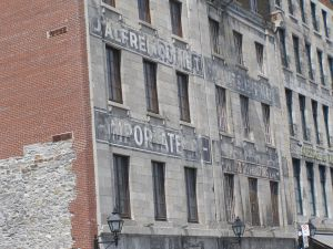 Fading history clings tightly to the crumbling facade on Montreal's river front.