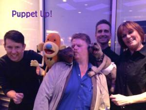 (L-to-R) Brian Clark, Grant Baciocco and Peggy Etra surround me with puppet love
