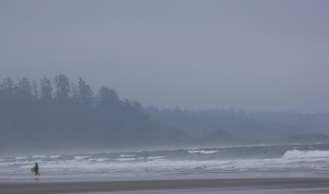 A surfer finds joy on a blustery day in Tofino, BC