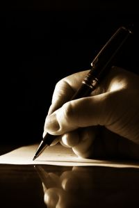 Hand-writing-on-paper-with-pen1