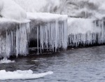 A curtain of icicles dip into the lake