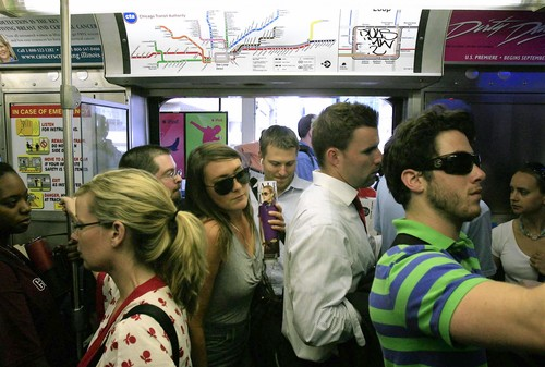 Passengers crowd the Brown Line train in the Loop at evening rush hour, Wednesday, July 16, 2008. The CTA plans to eliminate seats in some train cars to alleviate crowding. (Chicago Tribune photo by Alex Garcia) ..OUTSIDE TRIBUNE CO.- NO MAGS,  NO SALES, NO INTERNET, NO TV, CHICAGO OUT.. 00296065A TrainSeats