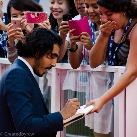 After premiering his movie, Dev Patel came back out to embrace his fans.